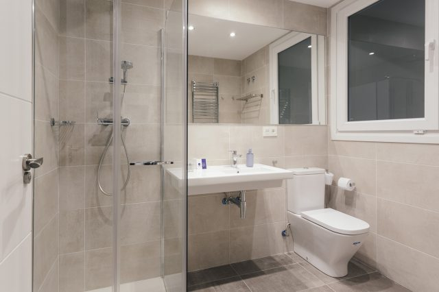 Large room with a double bed and a shared bathroom